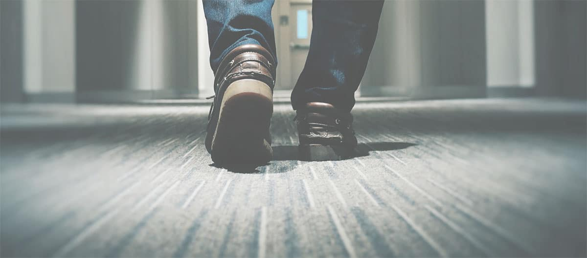 Feet walking on commercial glue down carpet after office carpet cleaning in Denver