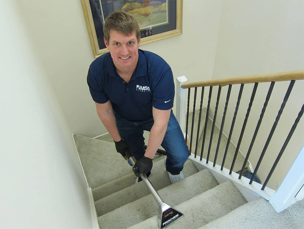 Andrew Cleaning Carpets in Home