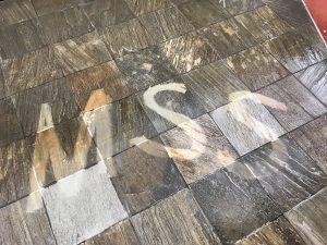 MSS Written on tile floor