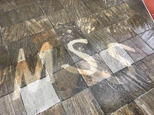 MSS name written with tile and grout cleaning
