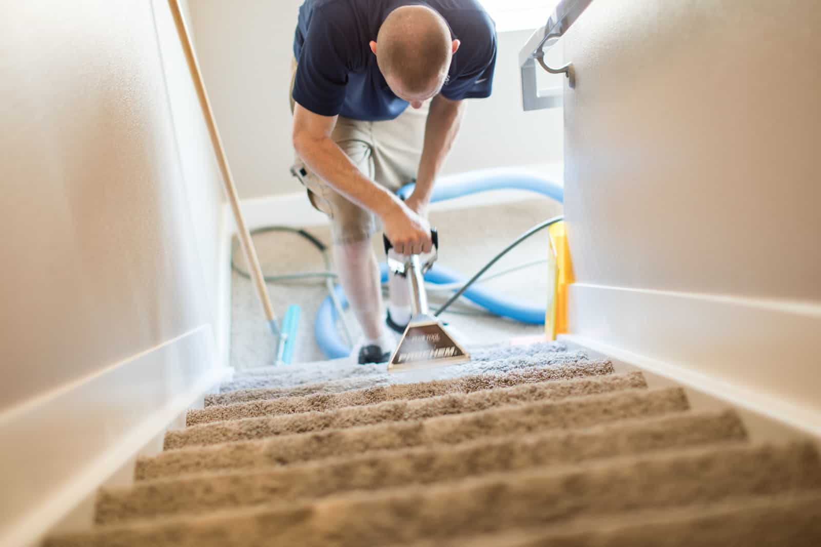 MSS Cleaning employee carpet cleaning staircase with a stair tool