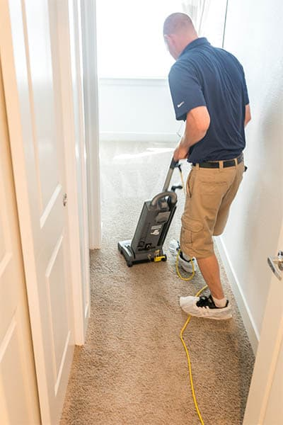 Pre-vacuuming before carpet cleaning using a commercial vacuum cleaner