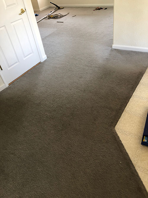 Brown carpet stretching in denver showing the after photo once the carpet had been stretched