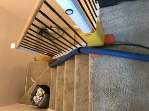 Corner guards and hose hook used to protect property during Denver CO carpet cleaning job