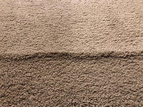 wrinkled buckling carpet