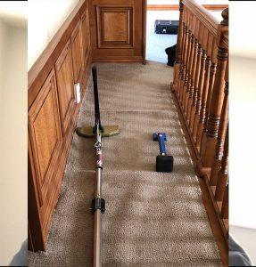 carpet stretching in hallway