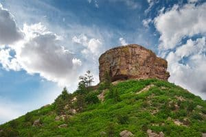 Castle Rock, CO with blue sky behind