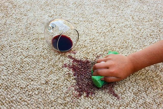 blotting grape juice stain with sponge