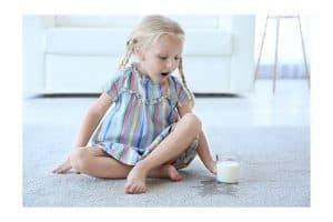 girl with spilled milk on carpet