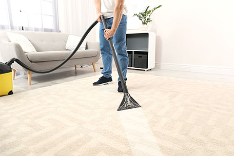 Man with rented carpet extractor