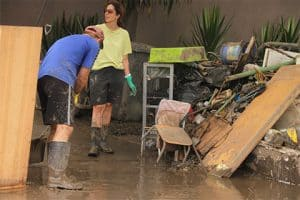 wearing rubber boots and gloves PPE water restoration